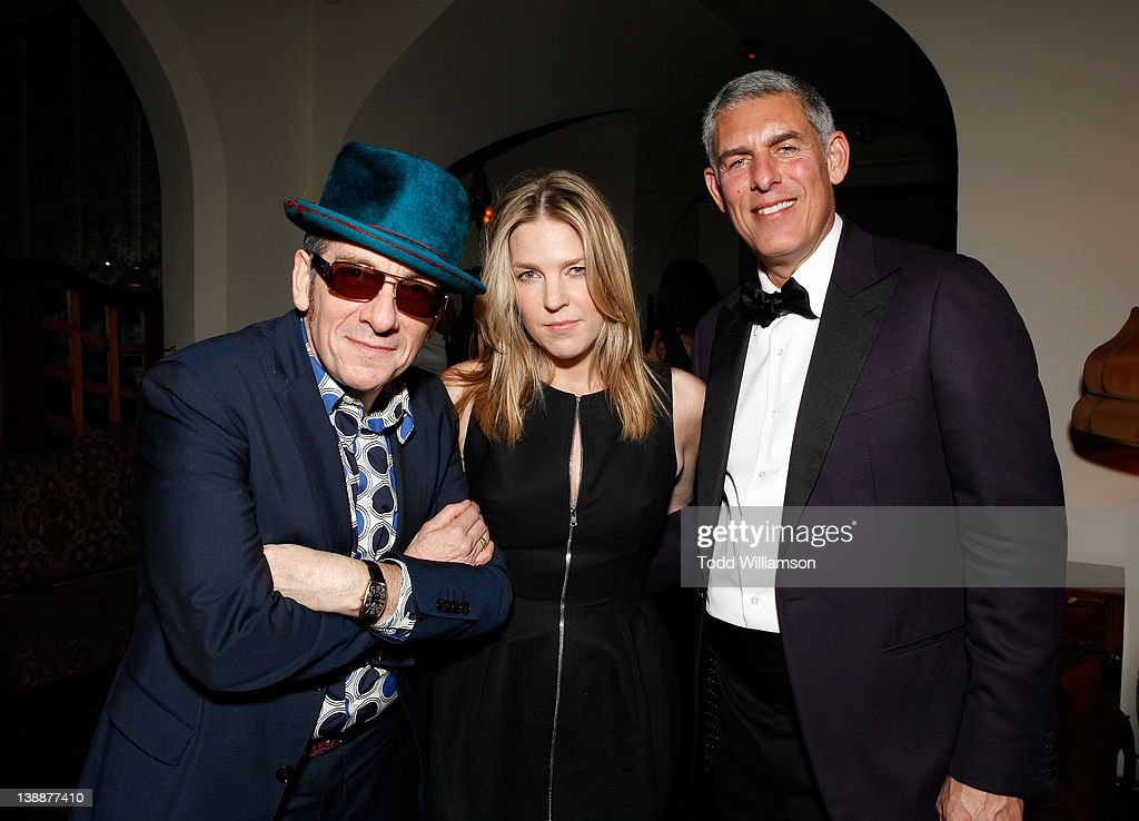 Musicians Elvis Costello, Diana Krall and North American Chairman and CEO of Recorded Music for Warner Music Group Lyor Cohen attend the Warner Music Group Grammy Celebration hosted by InStyle at the Chateau Marmont on February 12, 2012 in Los Angeles, California
