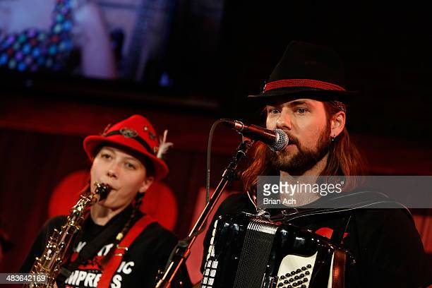 Musicians Emily Burke and Jake Kouwe of The Chardon Polka Band perform at the REELZ Channel upfront presentation at Hudson Hotel on April 9 2014 in...