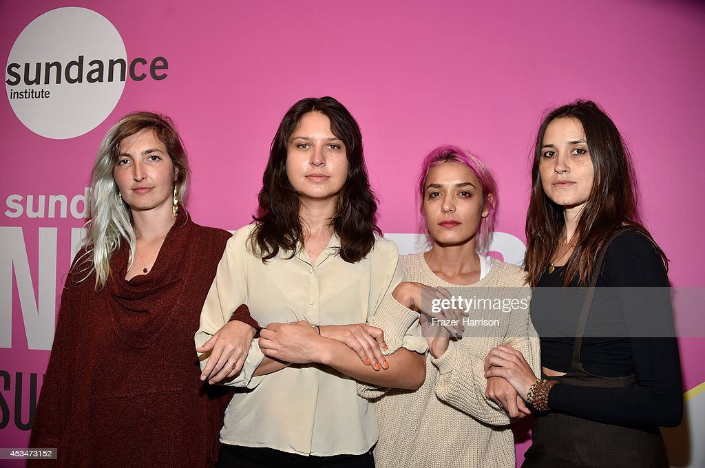 Musicians Emily Kokal, Stella Mozgawa, Jenny Lee Lindberg and Theresa Wayman of Warpaint attend the screening of 'A Girl Walks Home Alone at Night' with Warpaint in concert during Sundance NEXT FEST at The Theatre at Ace Hotel on August 10, 2014 in Los Angeles, California.