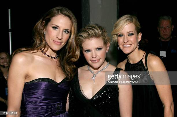 Musicians Emily Robinson Natalie Maines and Martie Maguire of The Dixie Chicks pose backstage at the 2006 American Music Awards held at the Shrine...