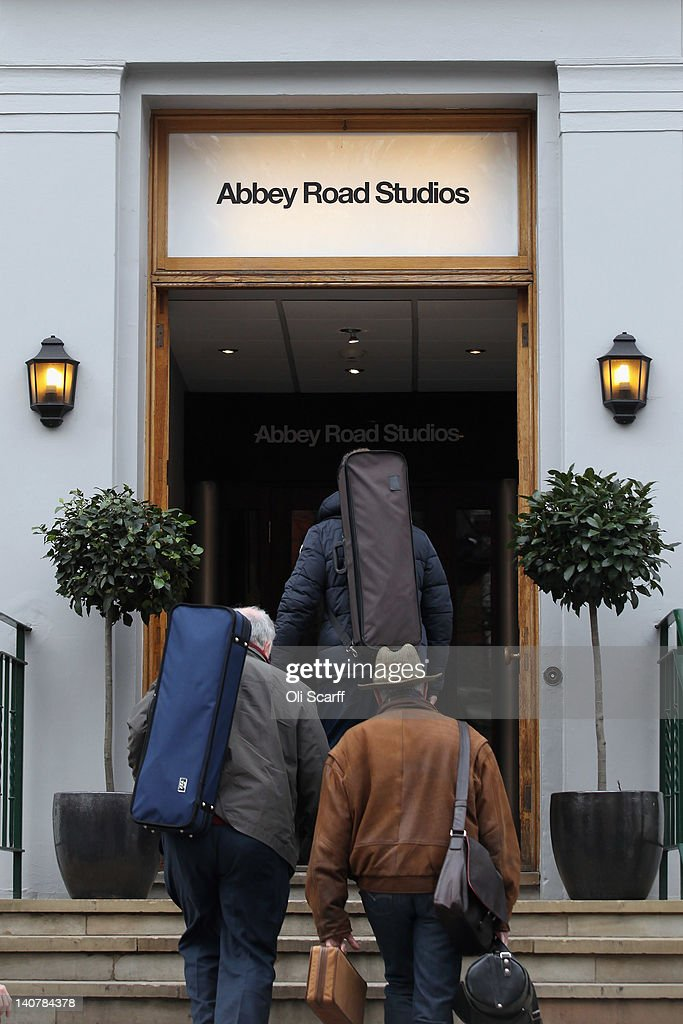 Musicians enter Abbey Road Studios in St John's Wood on March 5, 2012 in London, England. Abbey Road in North London has been made famous by 1960s bands such as The Beatles and Pink Floyd who recorded in Abbey Road Studios. In particular, the cover of The Beatles' 1969 album 'Abbey Road' features the band on the pedestrian zebra crossing outside the studio. The crossing has become a popular destination for Beatles fans from around the world.