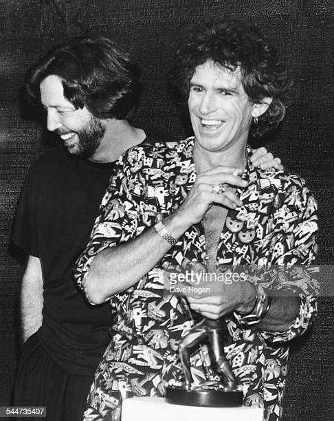 Musicians Eric Clapton and Keith Richards laughing together at the International Rock Awards June 2nd 1989