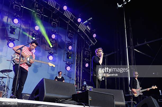 Musicians Eric Harvey Ethan Miller John Britt Daniel and Stephen J Cohen of Spoon perform onstage during day 3 of the Firefly Music Festival on June...