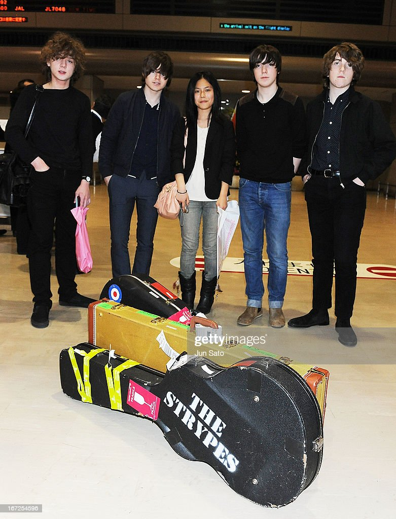 Musicians Evan Walsh, Josh McClorey, Ross Farrelly, Pete O'Hanlon of the Strypes pose for a photograph with a fan at Narita International Airport on April 23, 2013 in Narita, Japan.