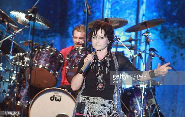 Musicians Fergal Lawler and Dolores O'Riordan of The Cranberries perform on stage during the concert at Hong Kong Convention and Exhibition Center on...
