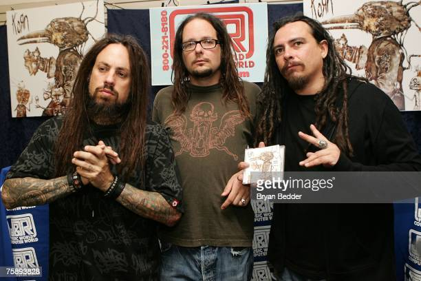 Musicians Fieldy Jonathan Davis and James Munky Shaffer of the band Korn appear at JR Music and Computer World for an autograph signing on July 31...