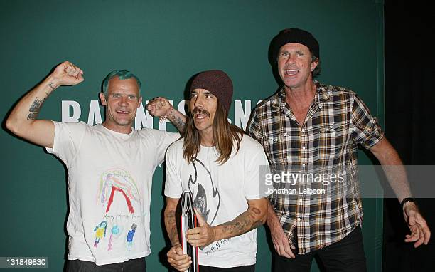 """Musicians Flea, Anthony Kiedis and Chad Smith arrive to sign copies of their new book """"Red Hot Chili Peppers: An Oral/Visual History"""" at Barnes &..."""