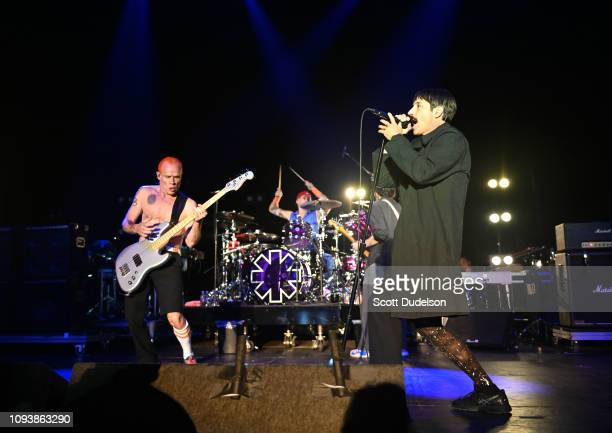 Musicians Flea Chad Smith and Anthony Kiedis of Red Hot Chili Peppers perform onstage during the Malibu Love Sesh Benefit Concert at Hollywood...