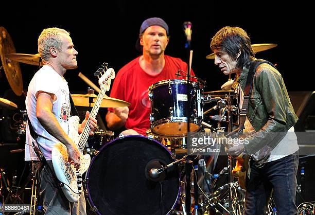 Musicians Flea Chad Smith and Ronnie Wood perform at the 5th Annual MusiCares MAP Fund Benefit Concert on May 8 2009 in Los Angeles California The...