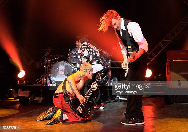 Musicians Flea Chad Smith Anthony Kiedis and Josh Klinghoffer of The Red Hot Chili Peppers perform onstage during the DirecTV Super Saturday Night...
