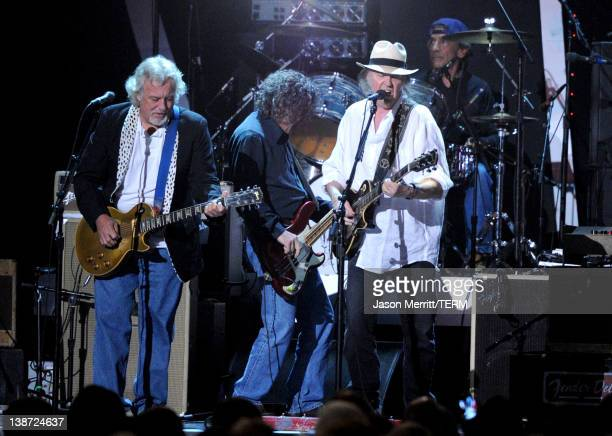 Musicians Frank Sampedro, Billy Talbot, Neil Young, Ralph Molina of the band Crazy Horse perform onstage at the 2012 MusiCares Person of the Year...