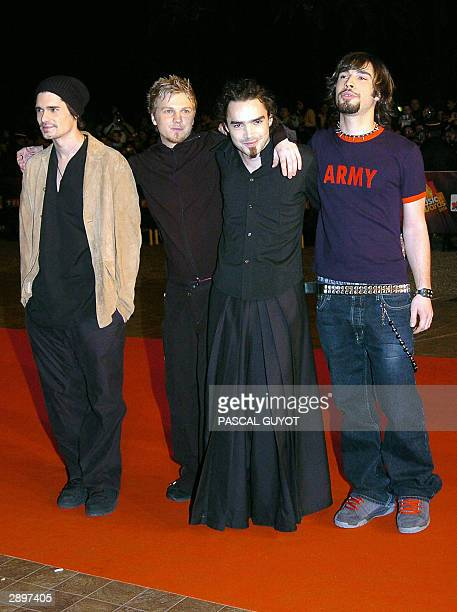 Musicians from French rock group Kyo arrive 24 January 2004 at Cannes' Palais des Festivals for France's annual NRJ music awards The awards are held...