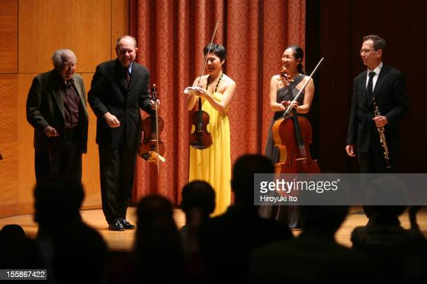 Musicians from Marlboro congratulating American composer Elliott Carter , after they performed his 'Oboe Quartet' at the Metropolitan Museum, New...