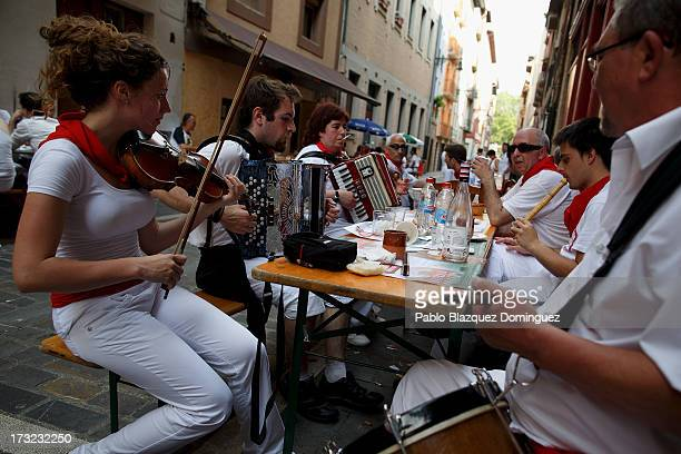 Musicians from Oberena play traditional Basque Country music in the street after they had lunch on the fifth day of the San Fermin Running Of The...