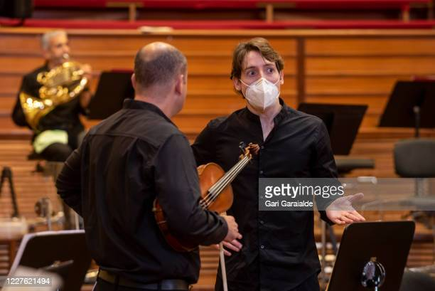 Musicians from the Basque Symphony Orchestra talk together before a concert that will be broadcast by public television on May 28 2020 in San...