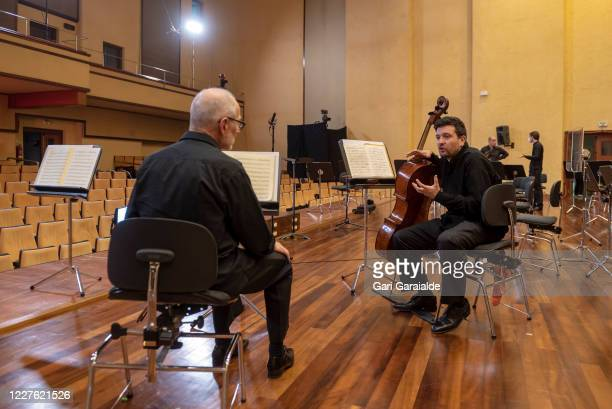 Musicians from the Basque Symphony Orchestra talk together before the concert that will be broadcast by public television on May 28 2020 in San...