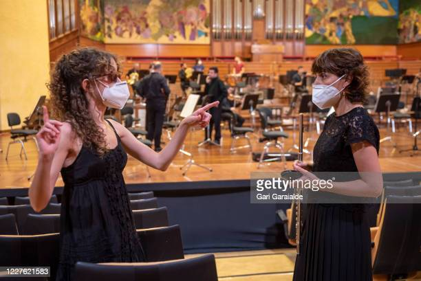 Musicians from the Basque Symphony Orchestra talk together concert that will be broadcast by public television on May 28 2020 in San Sebastian Spain...