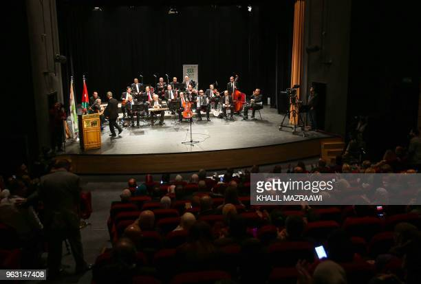 Musicians from the Beit alRowwad ensemble perform during a concert at Hussein Cultural Center in Amman on March 20 2018 Beit alRowwad a group of...