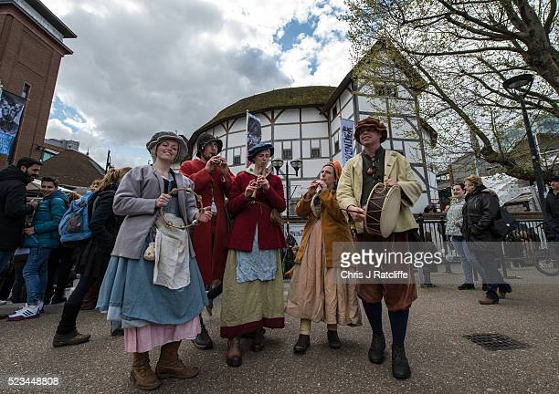 Musicians from the Kentwell Players in period dress play recorders drum and tamborine in front of Shakespeare's Globe Theatre as celebrations take...