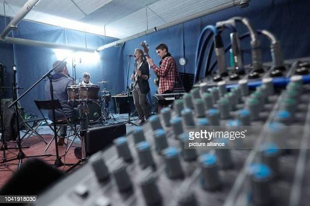 Musicians from the rock band Hot Barracho rehearse in a former airraid bunker inKoblenzGermany 26 June 2013 The rehearsal space is an example of...