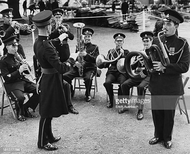 Musicians from the Royal Military School of Music at Kneller Hall playing at the Royal Military Academy Sandhurst in Berkshire, 15th July 1960. The...