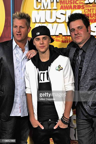 Musicians Gary LeVox Justin Bieber and Jay Demarcus attend the 2011 CMT Music Awards at the Bridgestone Arena on June 8 2011 in Nashville Tennessee