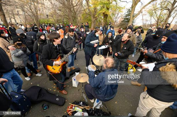 Musicians gather to honor John Lennon on the 40th anniversary of his death at Strawberry Fields in Central Park on December 08, 2020 in New York...