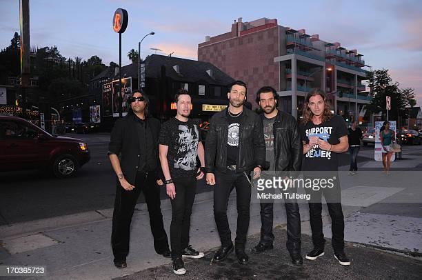 Musicians Gaurav Bali Luis Espaillat Taki Sassaris Alex Sassaris and Adam Latiff of the rock group Eve To Adam pose in front of at The Roxy Theatre...