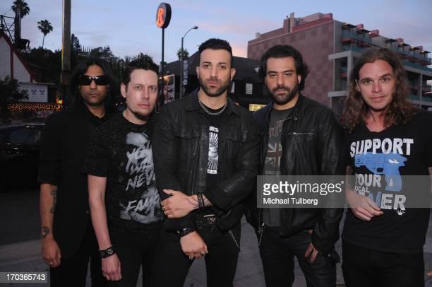Musicians Gaurav Bali Luis Espaillat Taki Sassaris Alex Sassaris and Adam Latiff of the rock group Eve To Adam pose in front of The Roxy Theatre on...