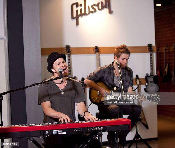 Musicians Gavin DeGraw and Billy Norris perform onstage at Microsoft's Shape The Future Program To Benefit VH1 Save The Music at Gibson Guitar...