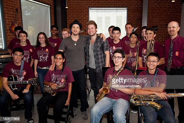 Musicians Gavin DeGraw and Billy Norris pose with student musicians from the Sherman Oaks Center for Enriched Studies at Microsoft's Shape The Future...