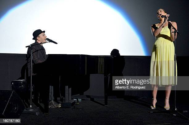 Musicians Gavin DeGraw and Colbie Caillat perform during the premiere of Relativity Media's Safe Haven at TCL Chinese Theatre on February 5 2013 in...