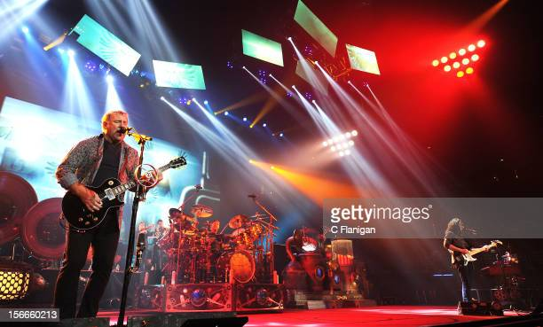 Musicians Geddy Lee Alex Lifeson and Neil Peart of RUSH perform during the Clockwork Angels Tour at Honda Center on November 17 2012 in Anaheim...