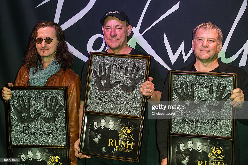 Rock Band Rush Gets Inducted Into Guitar Center's Historic RockWalk