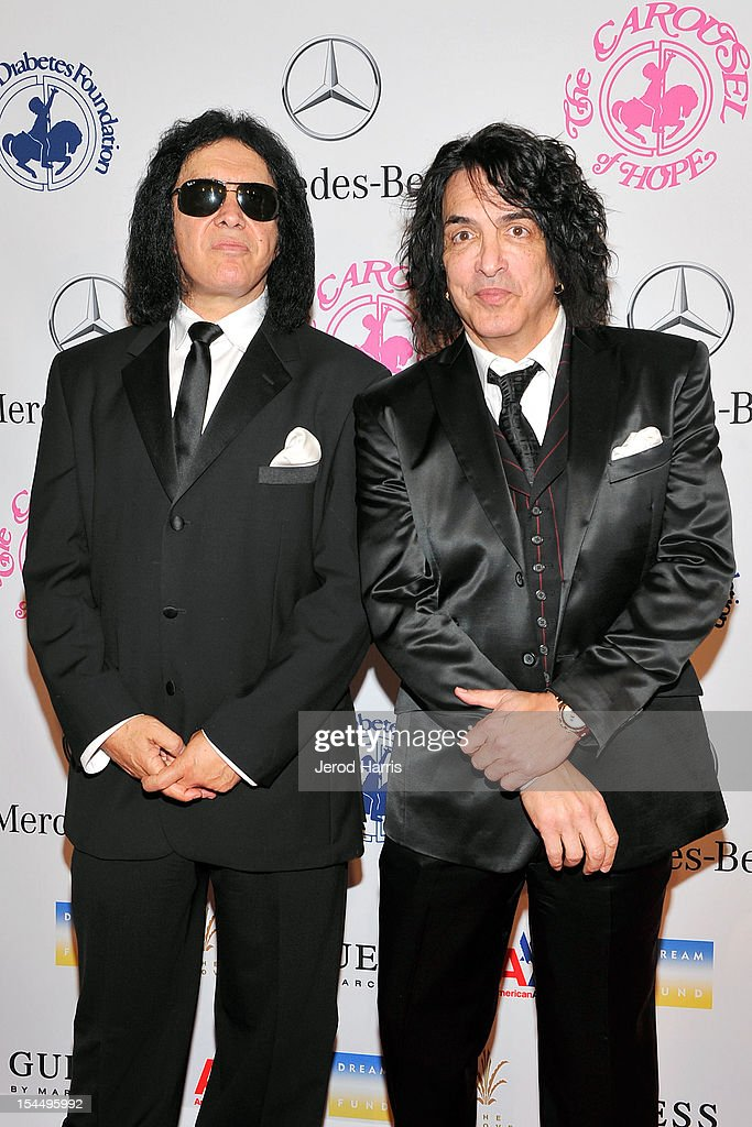 Musicians Gene Simmons (L) and Paul Stanley arrive at Mercedes-Benz presents The Carousel Of Hope on October 20, 2012 in Los Angeles, California.