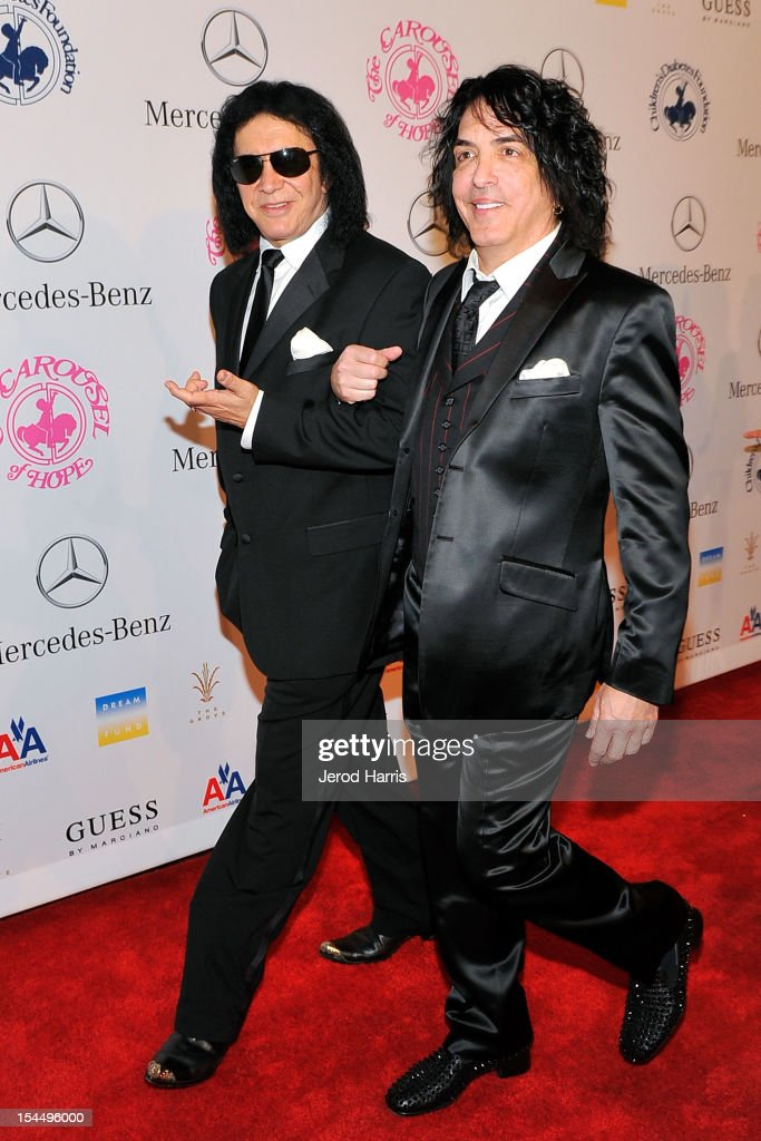 Musicians Gene Simmons (L) and Paul Stanley of KISS arrive at Mercedes-Benz presents The Carousel Of Hope on October 20, 2012 in Los Angeles, California.