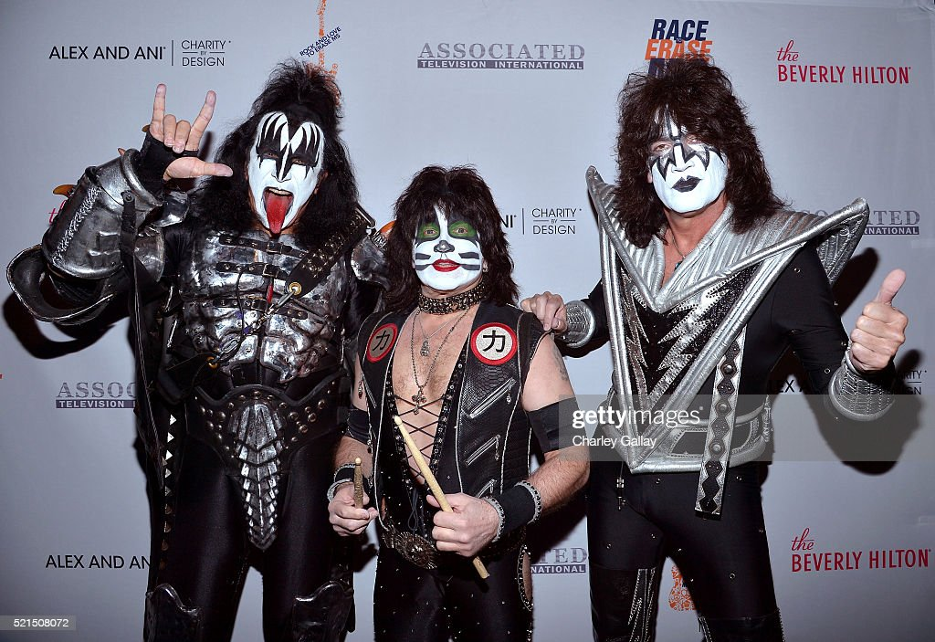 Musicians Gene Simmons, Eric Singer and Tommy Thayer of KISS attend the 23rd Annual Race To Erase MS Gala at The Beverly Hilton Hotel on April 15, 2016 in Beverly Hills, California.