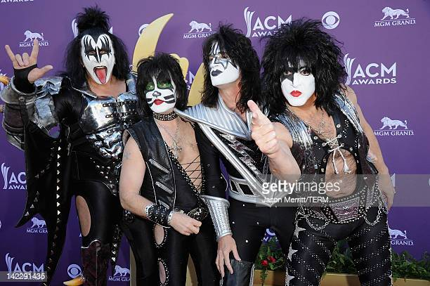 Musicians Gene Simmons Eric Singer Tommy Thayer and Paul Stanley of the rock band Kiss arrive at the 47th Annual Academy Of Country Music Awards held...