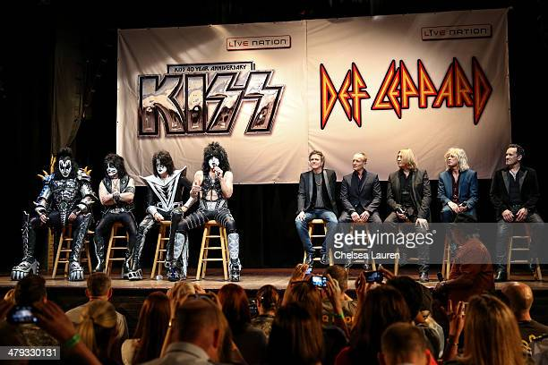 Musicians Gene Simmons Eric Singer Tommy Thayer and Paul Stanley of KISS and Rick Allen Phil Collen Joe Elliott Rick Savage and Vivian Campbell of...