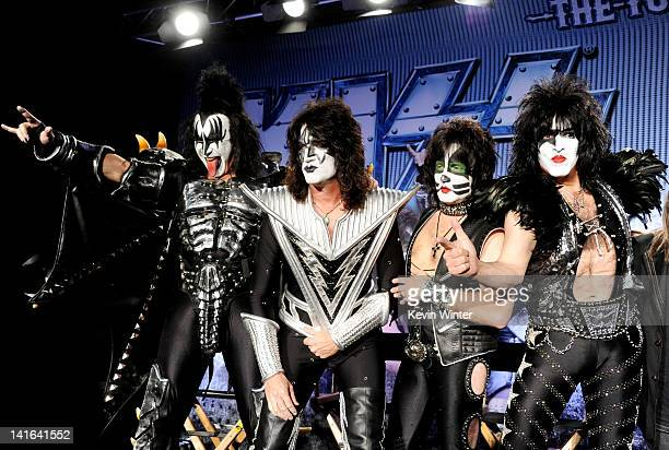 Musicians Gene Simmons Tommy Thayer Eric Singer and Paul Stanley appear onstage to announce their upcoming Motley Crue and KISS coheadlining tour at...