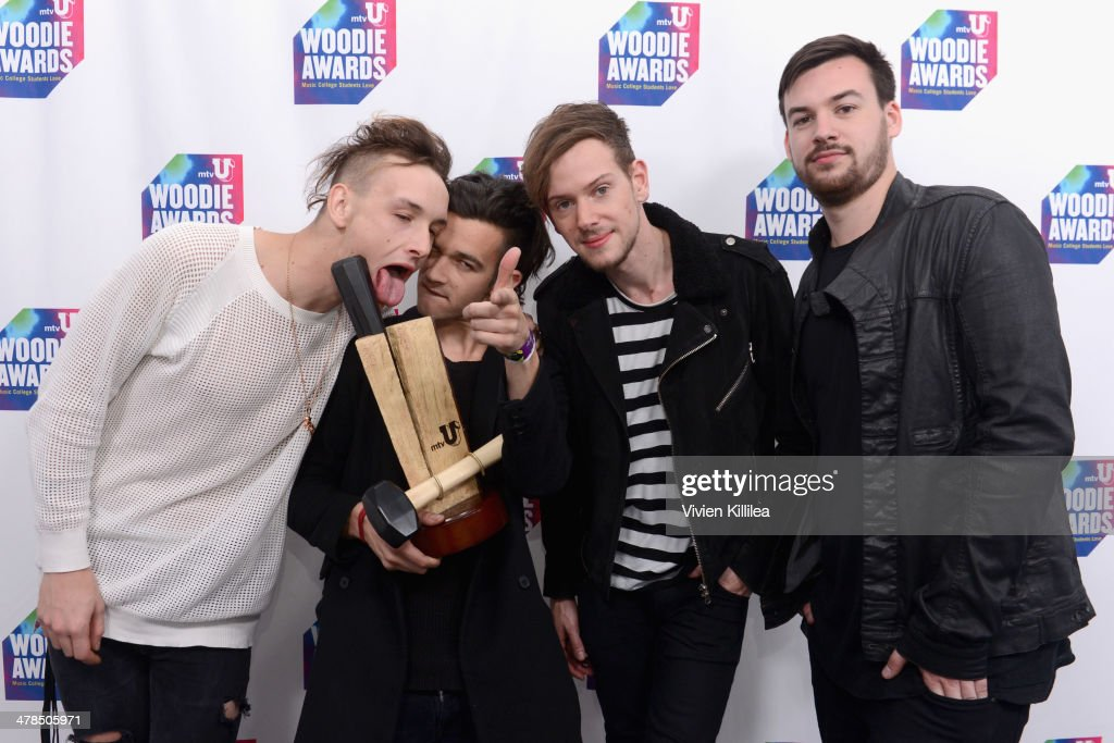 Musicians George Daniel, Matthew Healy, Adam Hann, and Ross MacDonald, of The 1975, pose with award at the 2014 mtvU Woodie Awards and Festival on March 13, 2014 in Austin, Texas.