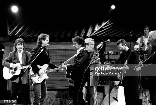 Musicians George Harrison Bob Dylan GE Smith and Eric Clapton are photographed behind the scenes of Bob Dylan's 30th Anniversay Concert on October 16...
