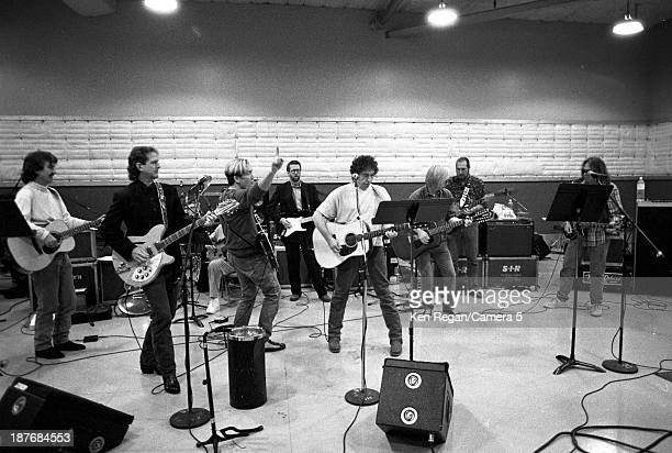 Musicians George Harrison GE Smith Bob Dylan Eric Clapton Tom Petty and Neil Young are photographed behind the scenes of Bob Dylan's 30th Anniversay...