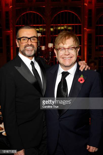 Musicians George Michael and Sir Elton John attend a charity performance benefiting the Elton John AIDS Foundation's newly created Elizabeth Taylor...