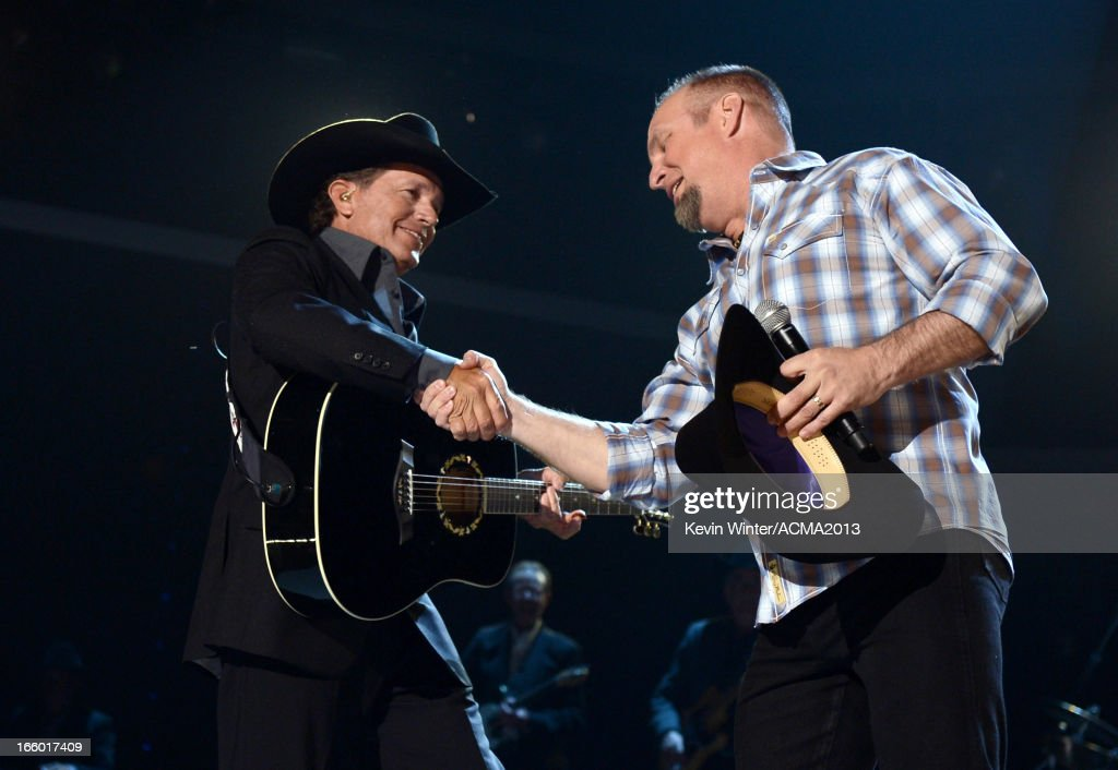 Musicians George Strait (L) and Garth Brooks perform onstage during the 48th Annual Academy of Country Music Awards at the MGM Grand Garden Arena on April 7, 2013 in Las Vegas, Nevada.