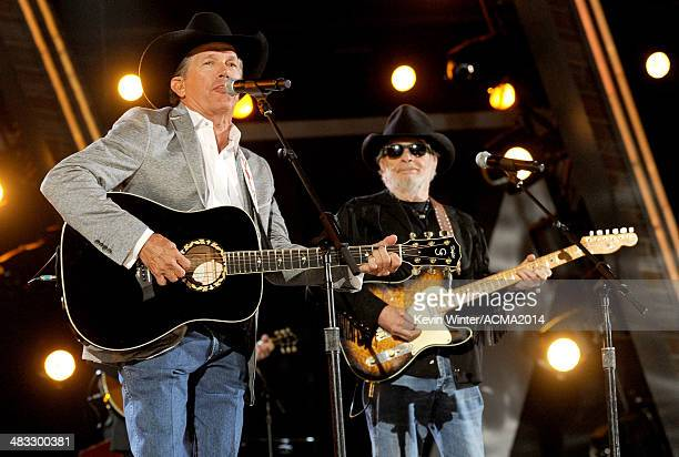 Musicians George Strait and Merle Haggard perform onstage during ACM Presents: An All-Star Salute To The Troops at the MGM Grand Garden Arena on...