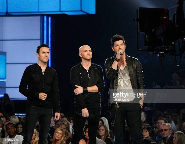Musicians Glen Power Mark Sheehan and Danny O'Donoghue of The Script speak onstage during the 2011 Billboard Music Awards at the MGM Grand Garden...