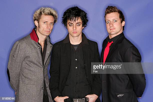 Musicians Green Day poses for a portrait during the 2004 Billboard Music Awards at the MGM Grand Garden Arena on December 8 2004 in Las Vegas Nevada