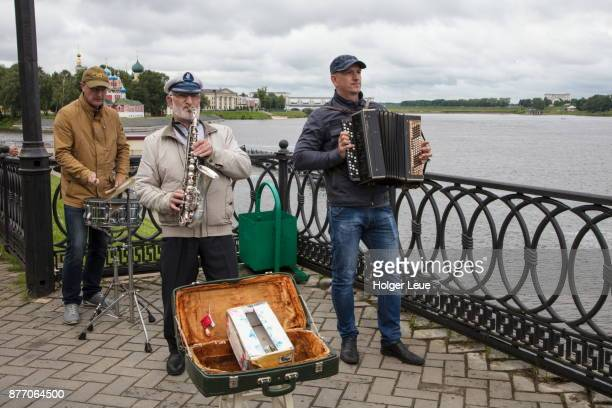 Musicians greet passengers from river cruise ships at pier, Uglich, Russia