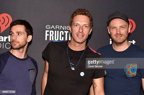 Musicians Guy Berryman Chris Martin and Jonny Buckland of Coldplay attend the 2015 iHeartRadio Music Festival at MGM Grand Garden Arena on September...